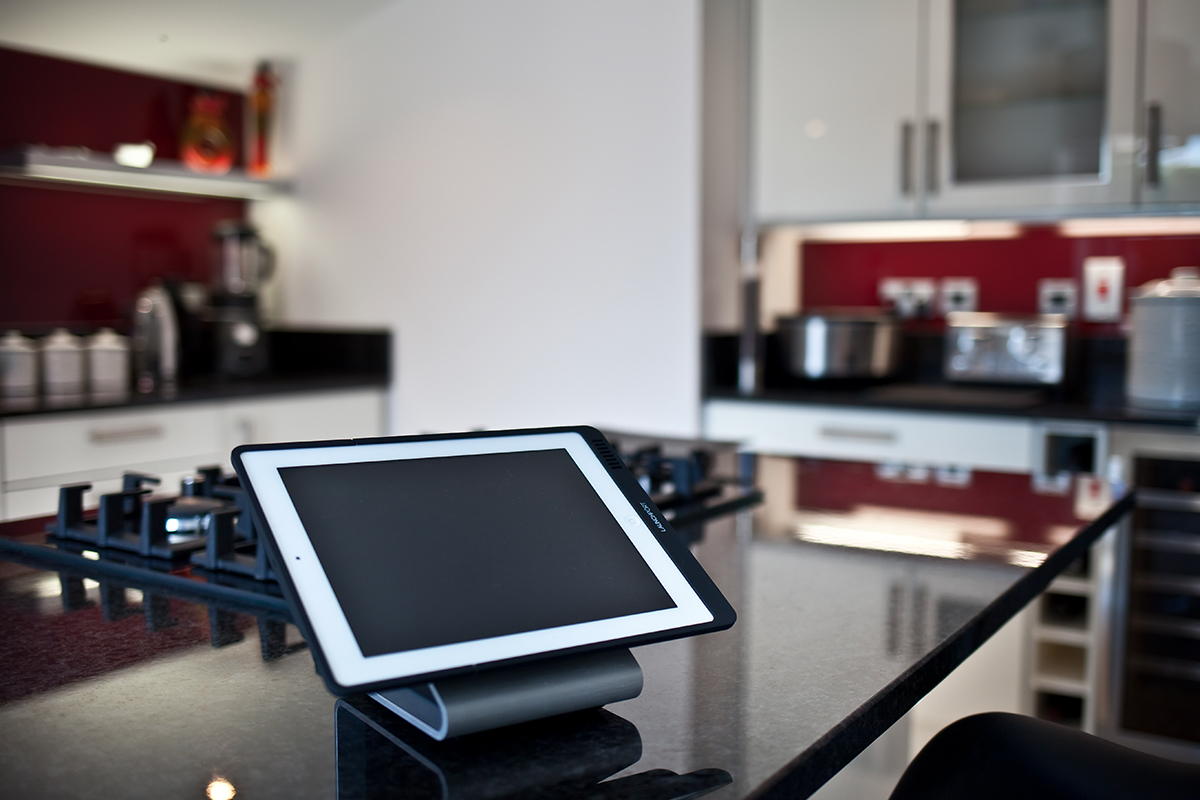 Tablet on a stand on a kitchen island